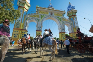 Seville, Spain, 8 may, 2014: People mounted on horse in the Cover of the Seville Fair.
