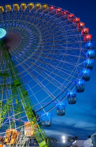 "Seville, Spain - April 23, 2015: Seville, Spain - April 23, 2015: Ferris wheel illuminated at night in april fair of Seville. Detail of ferris wheel illuminated at night in the april fair of Seville. Calle el Infierno: (Hell Street) rides areas adjacent to the Feria grounds. Thousands of people enjoy these torturous, ""infernal"" rides, making it one of the most popular and lively areas of the Feria."